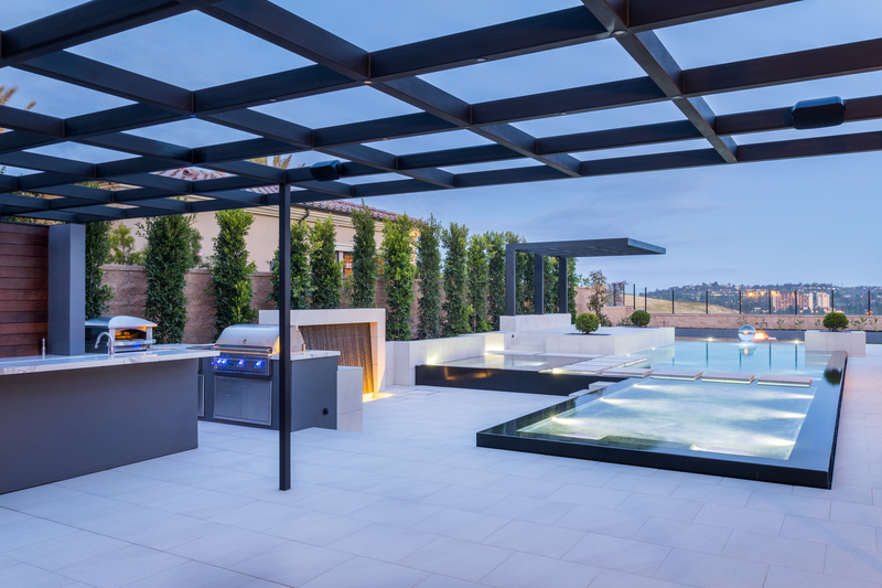 Irvine, CA water wall, outdoor kitchen, metal overhead structure, cantilever metal lanai, firepit, pool, baja lounge and spa